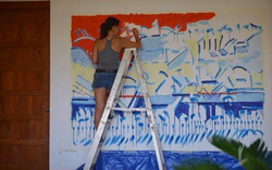 Photo of Constanza Blondet painting in theDominican Republicfrom 2014.[4]