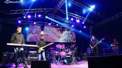 Image of ThatDragos (Dragos Budeanu) on stage, playing the guitar with his band