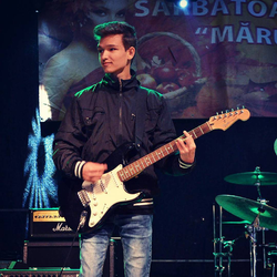 Image of ThatDragos (Dragos Budeanu) on stage, playing the guitar