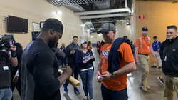 Christin Stewart trades an autographed game-used bat and a picture with a fan for the go-ahead grand-slam ball