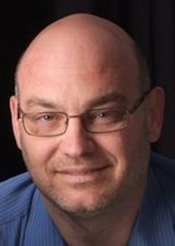 Headshot ofJon M. Quigley.