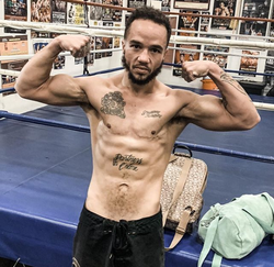 Patricio Manuel flexing outside the boxing ring  [10]