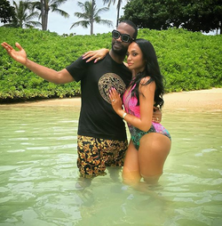 Regina Perera with her husband Juicy J​ at Aulani Beach cove (posted on Instagram on July 26, 2018)