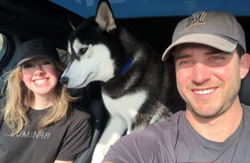 The couple pictured with their petHusky