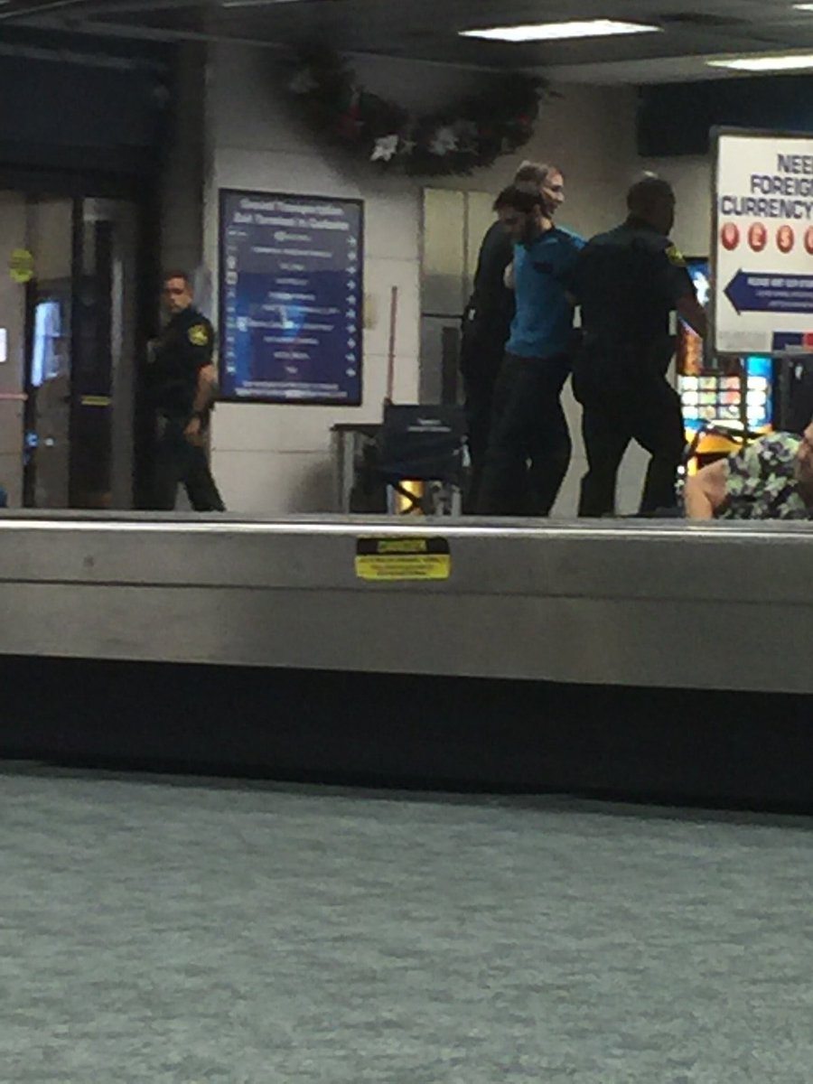 Photo of Esteban Santiago getting arrested after the Ft. Lauderdale Airport Shooting (January 6, 2017)