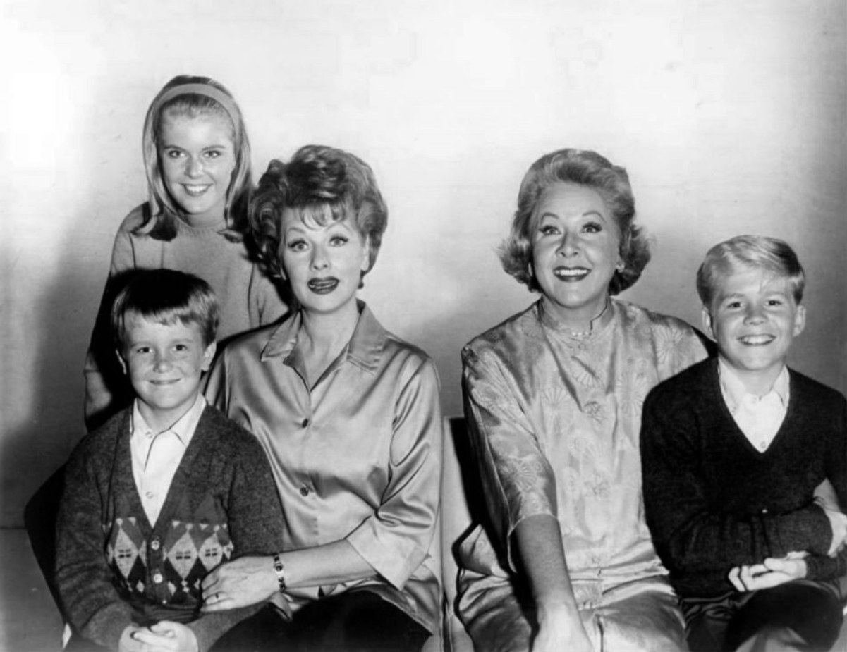"""Cast of <i><a href=""""/content/The_Lucy_Show"""" style=""""color:blue"""">The Lucy Show</a></i> during its first three seasons: Candy Moore (in back); front, L-R: Jimmy Garrett, <a href=""""/content/Lucille_Ball"""" style=""""color:blue"""">Lucille Ball</a>, <a href=""""/content/Vivian_Vance"""" style=""""color:blue"""">Vivian Vance</a>, and Ralph Hart (1962)"""