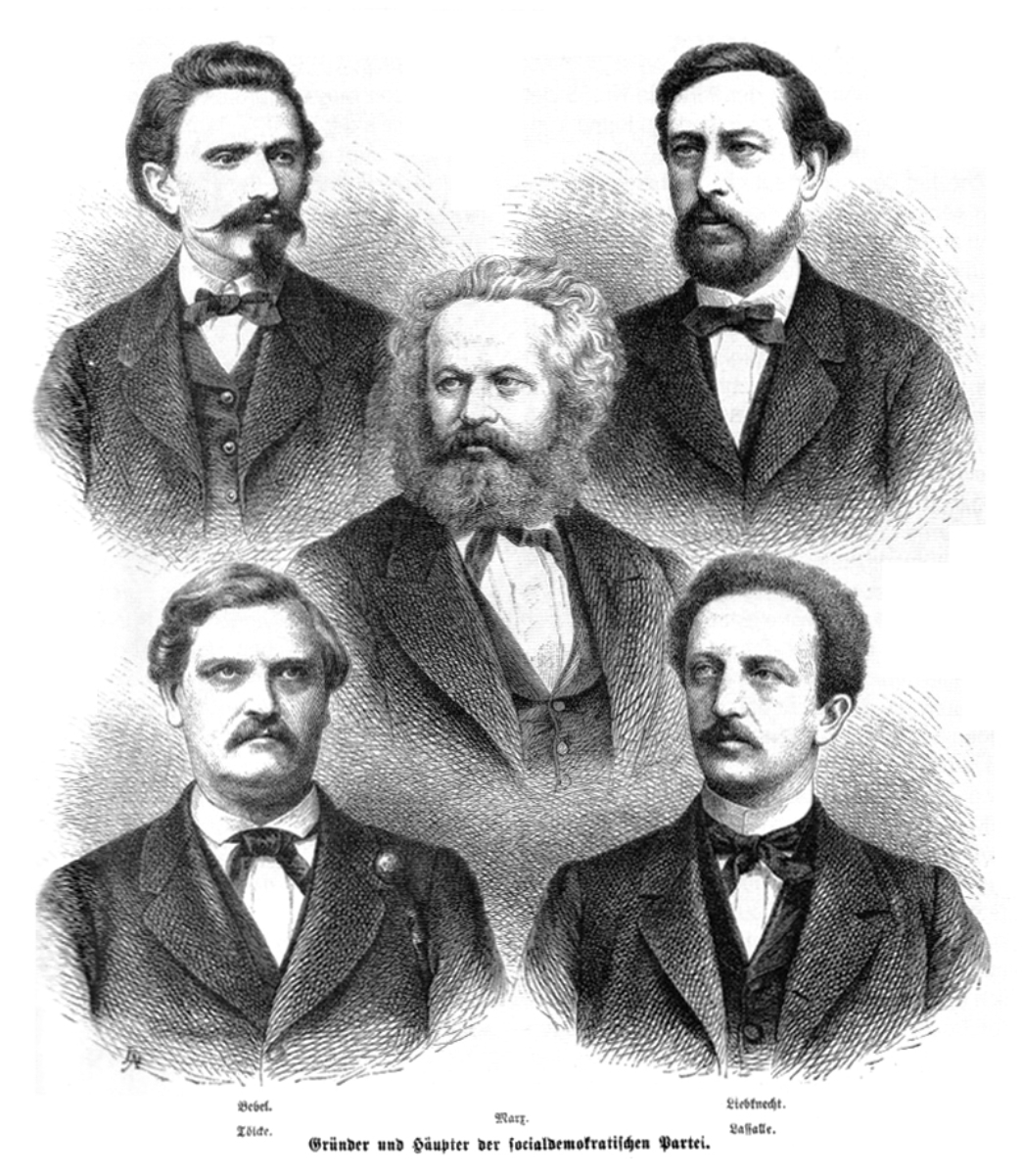 """Leaders of the early German worker's movement (above: <a href=""""/content/August_Bebel"""" style=""""color:blue"""">August Bebel</a>, <a href=""""/content/Wilhelm_Liebknecht"""" style=""""color:blue"""">Wilhelm Liebknecht</a>, in the center: <a href=""""/content/Karl_Marx"""" style=""""color:blue"""">Karl Marx</a>, below: Carl Wilhelm Tölcke, <a href=""""/content/Ferdinand_Lassalle"""" style=""""color:blue"""">Ferdinand Lassalle</a>)"""