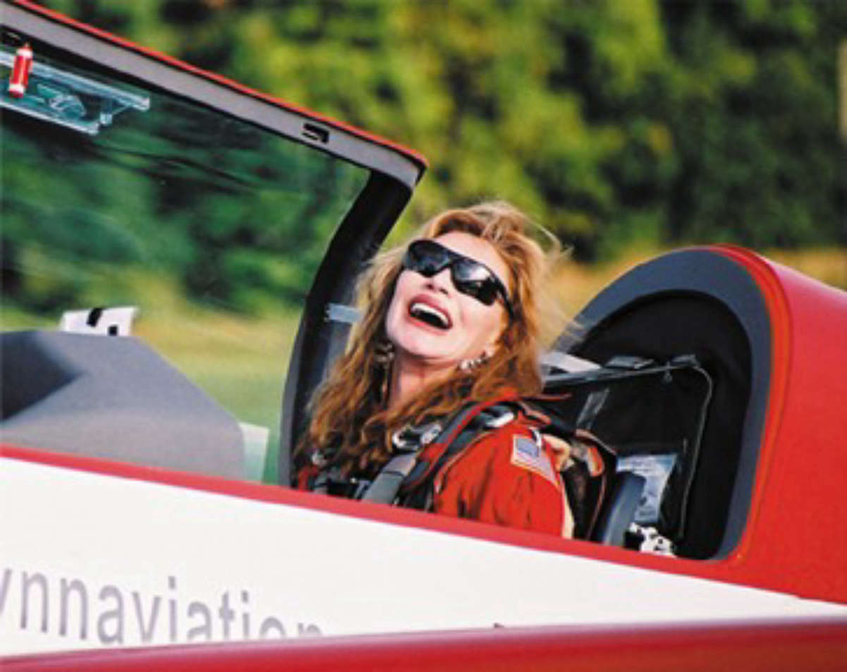 """Nancy Lynn in her <a href=""""/content/Extra_300"""" style=""""color:blue"""">Extra 300</a> aerobatic airplane."""